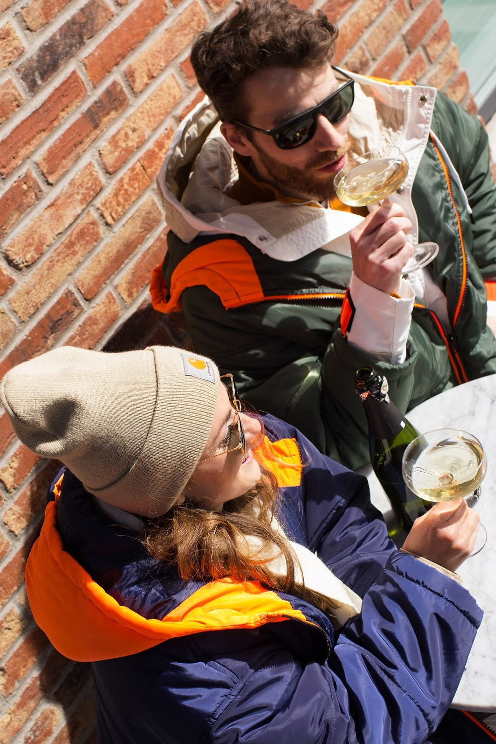 Couple drinking outside while wearing a Sittingsuit