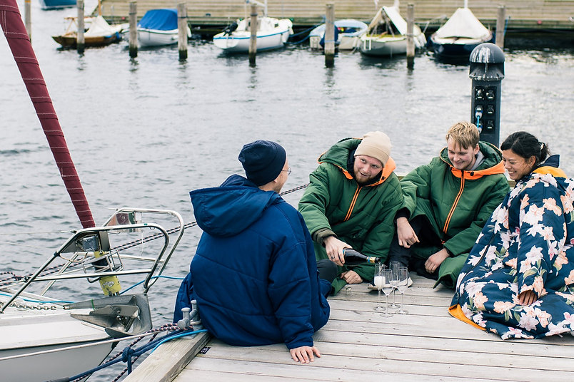 Friends in the marina sat in their warm Sittingsuits