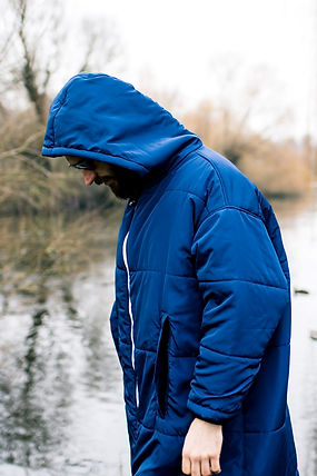 Man in his blue Sittingsuit from Norse Supply