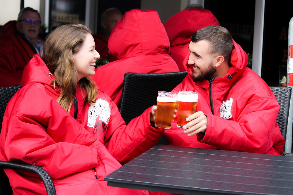 Pub-goers sat in customised Sittingsuits enjoying a pint