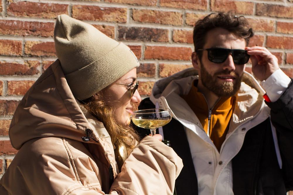 Couple enjoying a drink wearing a Sittingsuit