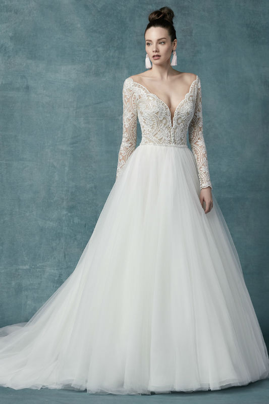 Wedding dresses with long sleeves are making a statement down the aisle.