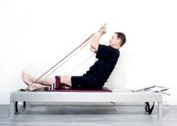 Pilates Reformer for Men.