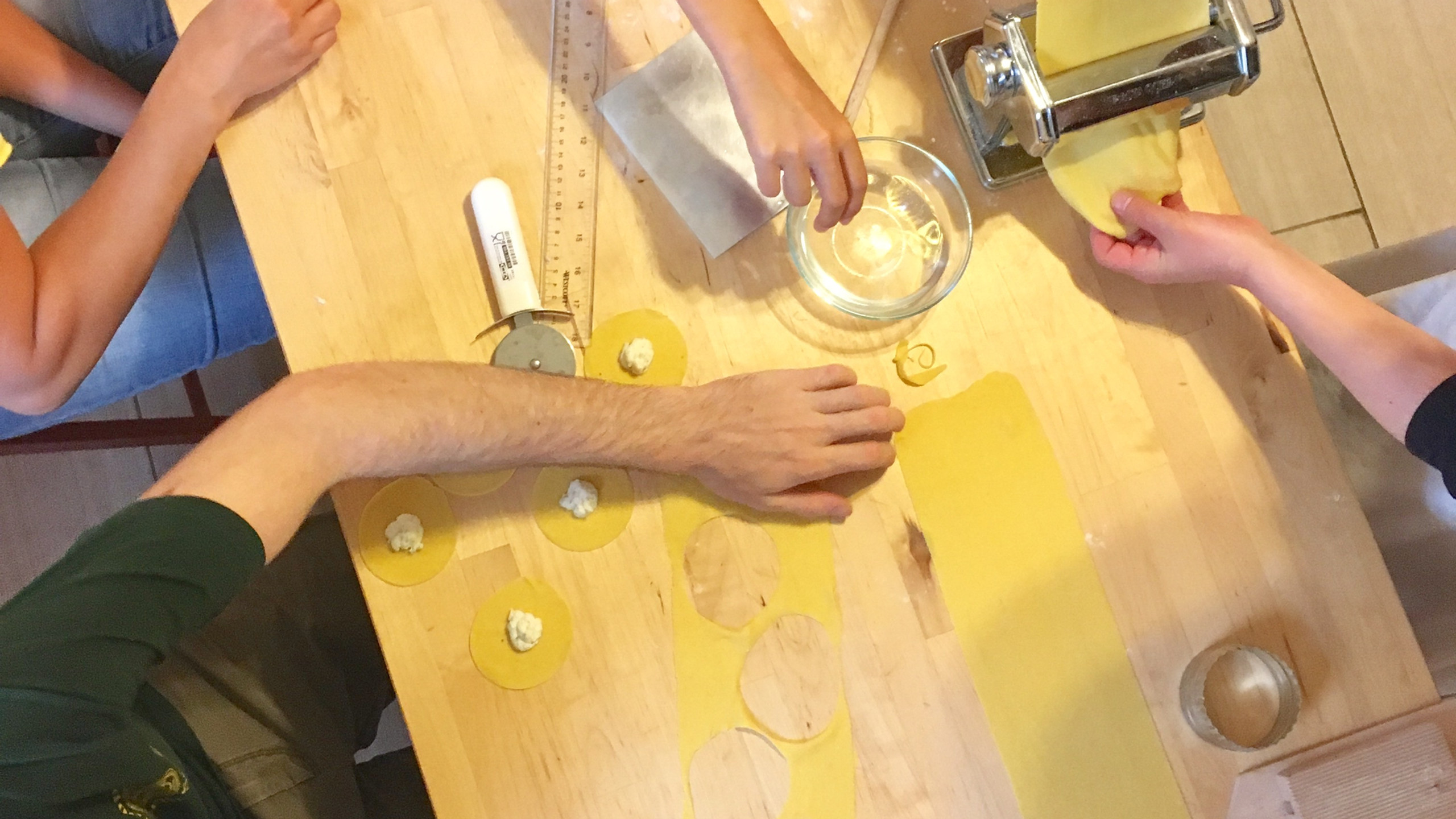 Rolling out the dough and making tortellini overhead, 100 days of pasta_