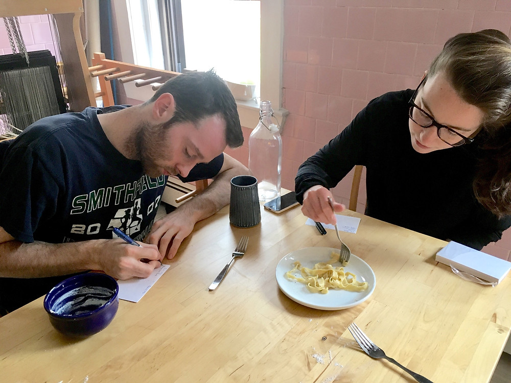 clare and garrett test different pasta types and dilligently take notes
