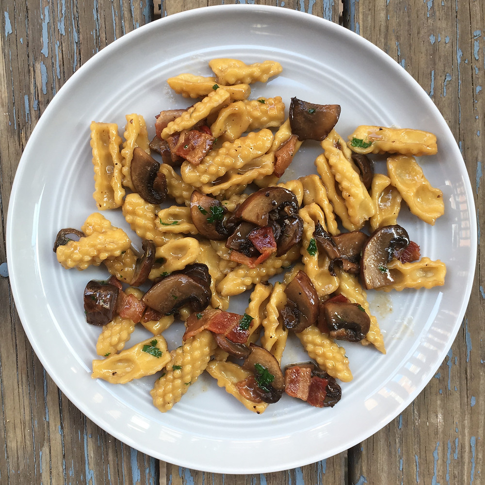 textured capunit with mushroonms and bacon