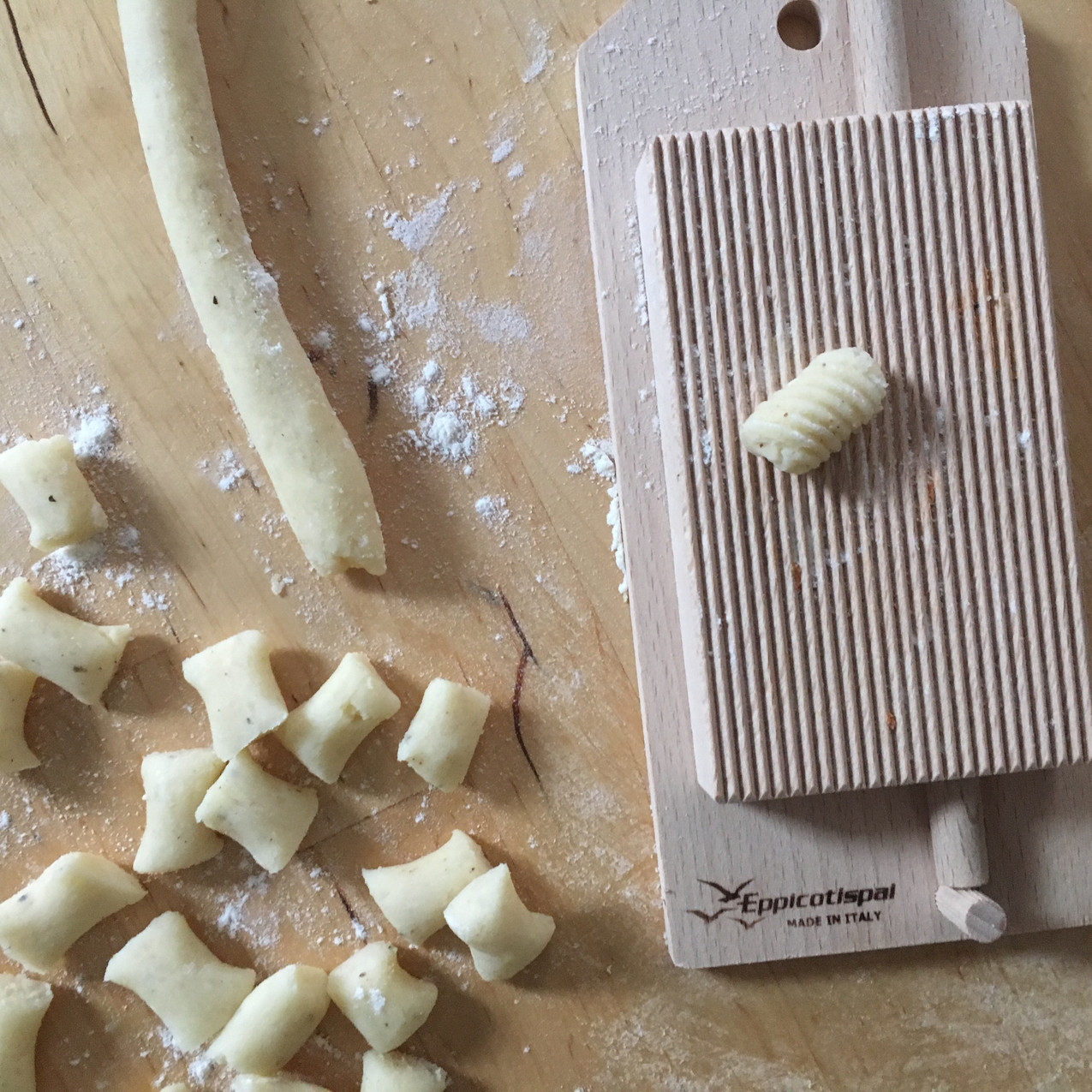 shaping gnocchi on a gnocchi board, 100 days of pasta