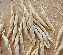 pile of trofie, handmade pasta, 100 days