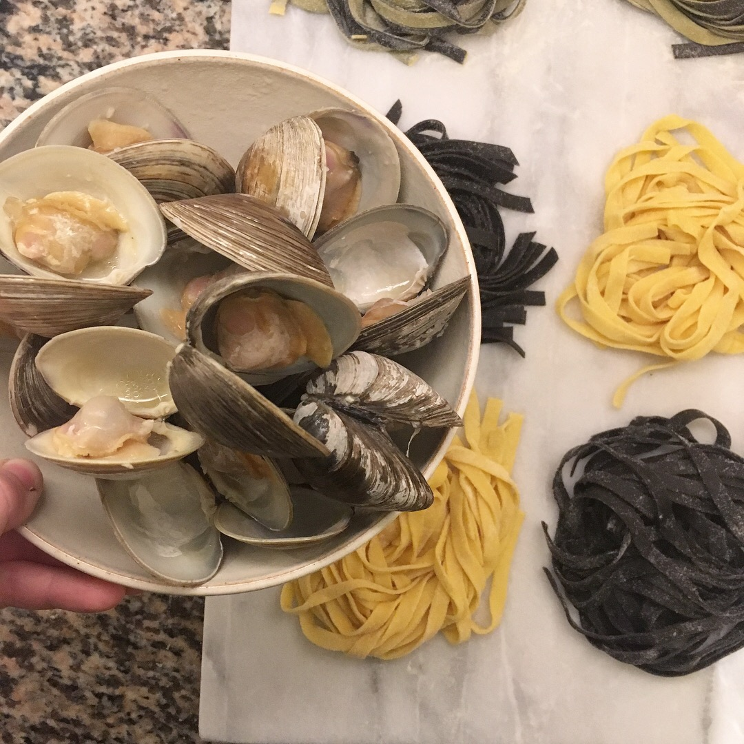 Black and yellow pasta with clams