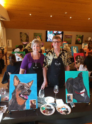 Living their best lives traveling & exploring the bar area. The tri color dog portrait is a gift for their son!