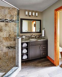 Remodeled master bathroom with walk in shower and backsplash