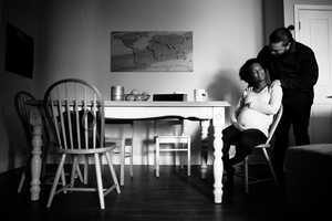 Albuquerque maternity photography - couple during their in home maternity photography session.