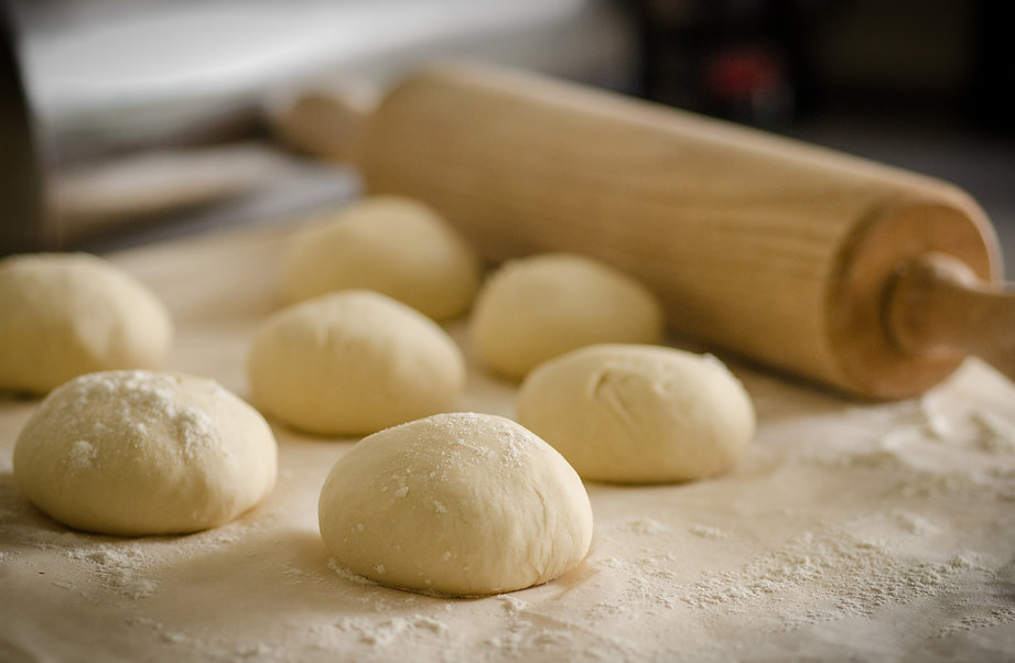 bread dough and rolling pin
