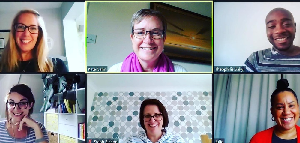 A zoom call screen with six people smiling