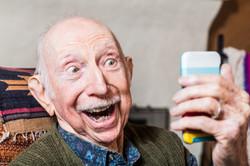 bigstock-Elderly-Gentleman-With-Smartph-98044727.jpg