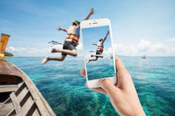 bigstock-Taking-Photo-Of-Snorkeling-Div-90945719.jpg