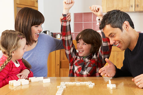 Family%20Playing%20Dominoes%20In%20Kitch