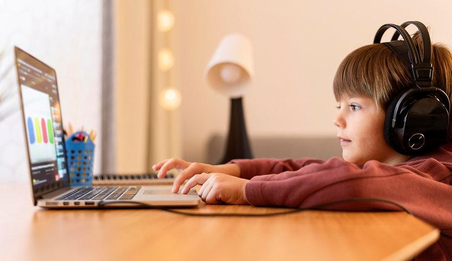 child-wearing-headphones-attending-virtu
