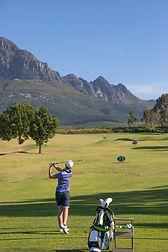 Man hitting golf balls at Erinvale Golf Club Driving Range.