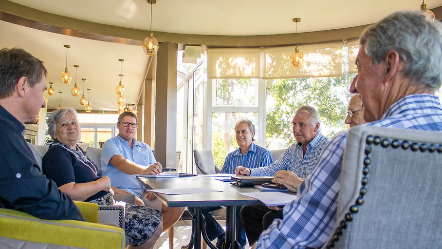 Erinvale Home Owners Association Trustees sitting around a table