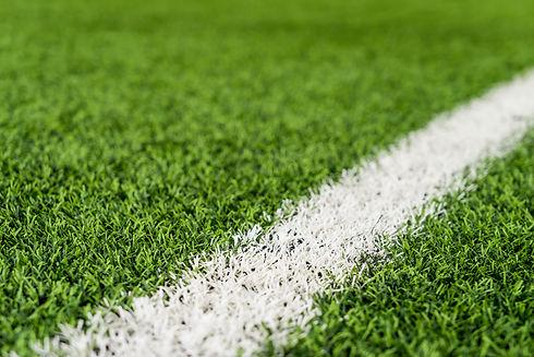 White line on Green grass sport field fo