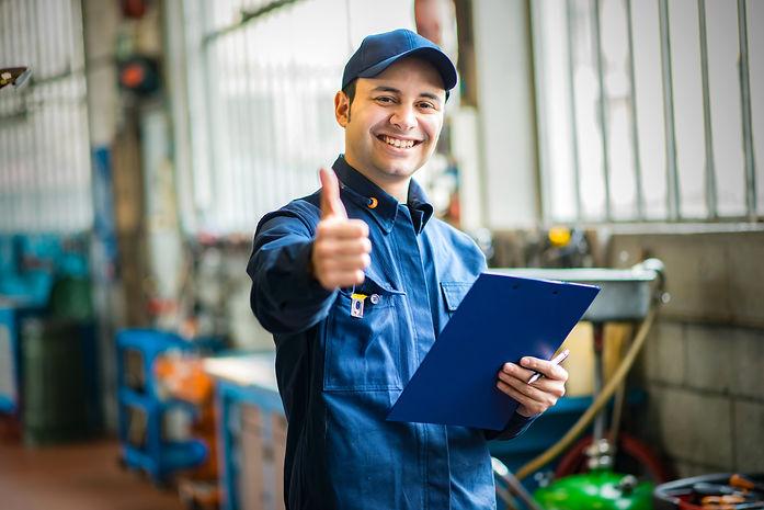 Smiling mechanic thumbs up.jpg