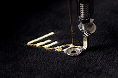 "embroidery of gold lettering ""luxury"" on"