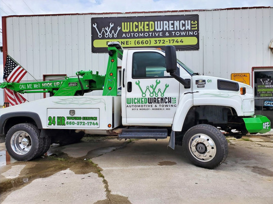 Tow truck vinyl graphics, lettering, logo
