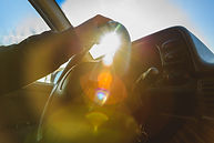 afternoon sun glare filled the car inter