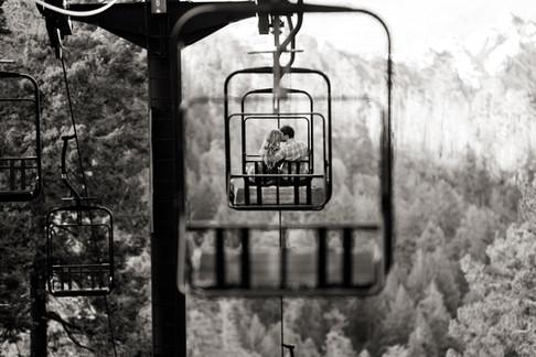engagement photos at ski resort lodge chair lift