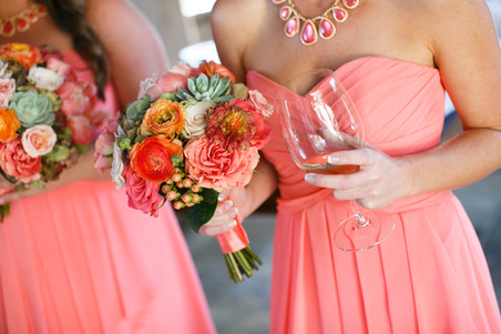 Coral bridesmaid dresses with bright bouquet of pretty flowers. orange, green, succulent, pink bridesmaids