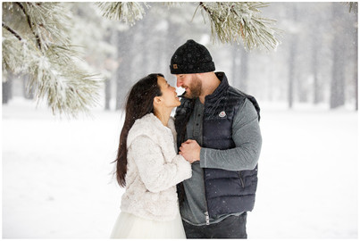 snowy engagement session in the winter snow