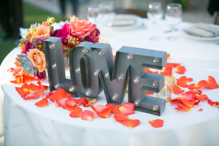 Light up LOVE sign for wedding. Coral and metal table decor. Singage.