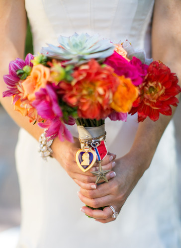 purple heart attached to bright brides bouquet, flower adornments, bridal bouquets, color, pink, orange, succulent, yellow, colorful
