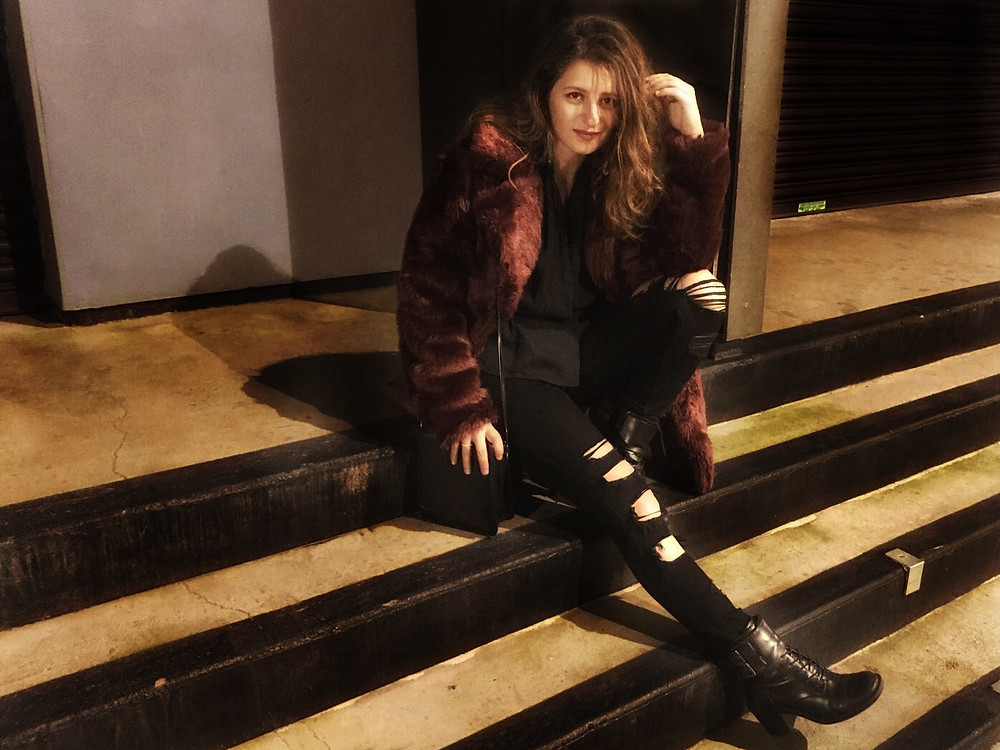Chilling on the steps in my fabulous fur coat