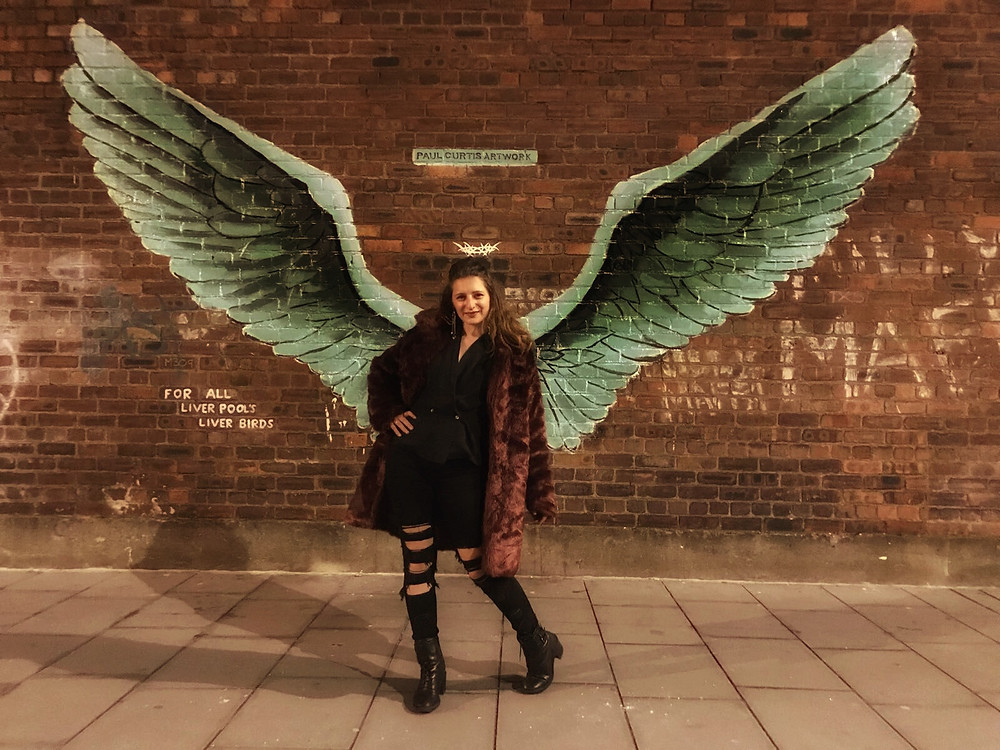 Let the coat (and the wings) do the talking
