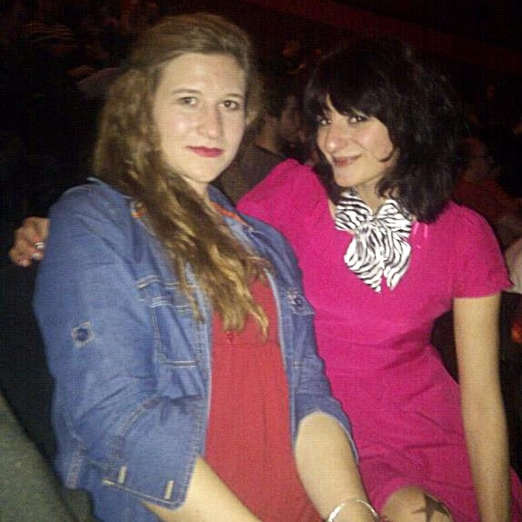 My sister and me circa 2009 - indie girl shaggy hair, bright pink dress, zebra print bow around my neck and star print tights!