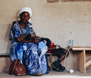 A jajja (grandmother) waiting with her grandson while he receives treatment