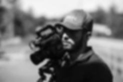 man with video camera on selective focus photography_edited.jpg