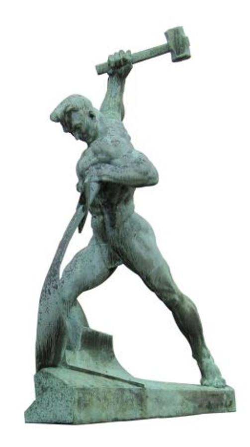 503px-Schwerter_zu_Pflugscharen_-_Bronze_-_Jewgeni_Wutschetitsch_-_Geschenk_der_Sowjetunion_an_die_UNO_-_1959