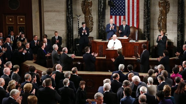 Members of the House and Senate applause as Pope Francis begins his address before a joint meeting of Congress on Capitol Hill in Washington, Thursday, Sept. 24, 2015, making history as the first pontiff to do so. (AP Photo/Carolyn Kaster)