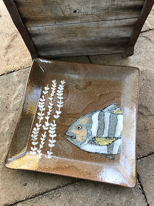 Striped fish with seaweed plate