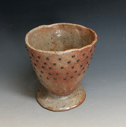 Pinched black dot cup