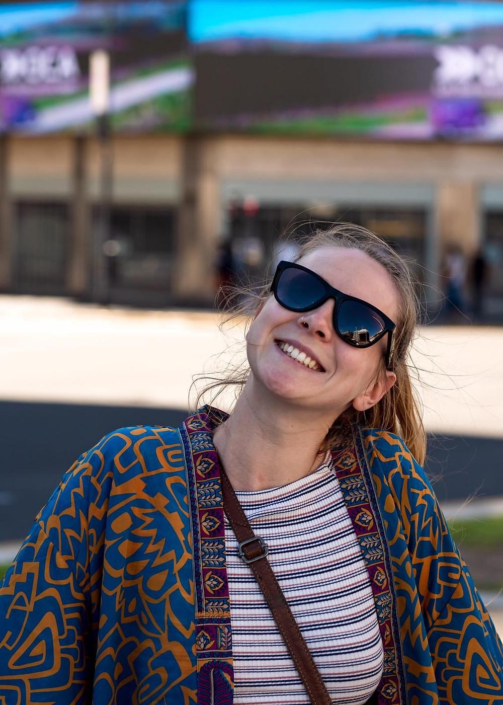 Blonde girl in kimono and sunglasses