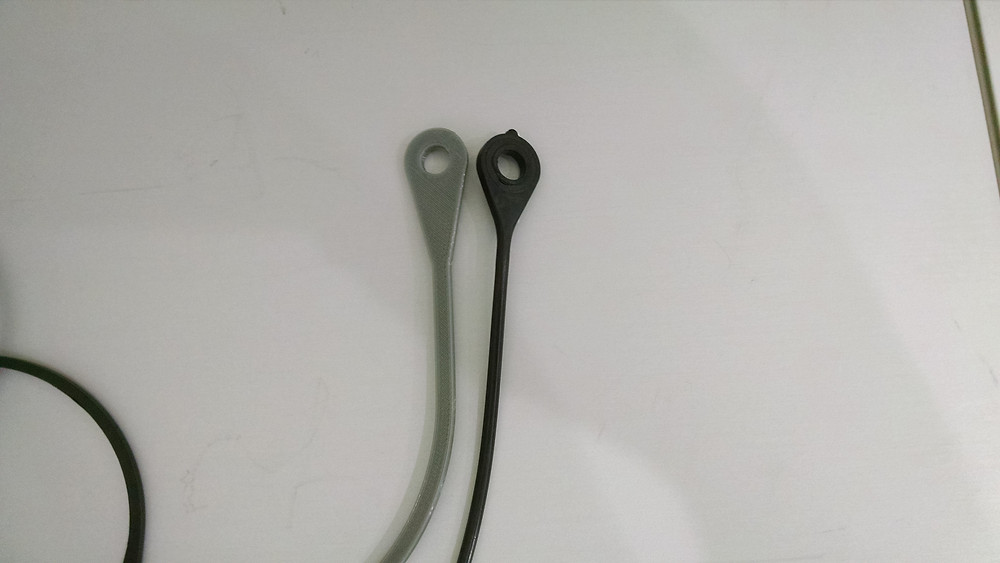 Replacement lanyard gas door pin area vs. OEM