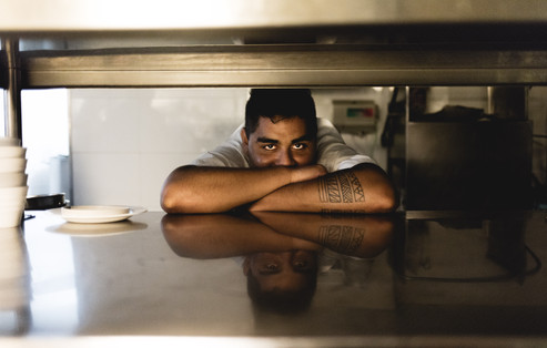 Raul awaits the dirty dishes