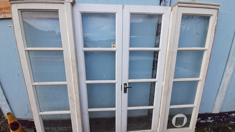 French doors with catflap keys and security locks
