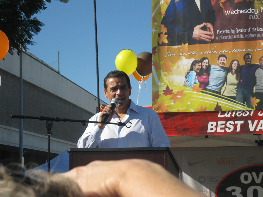 Mayor Villaraigosa front of Poster