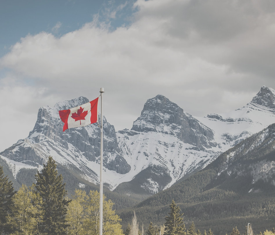 Canada Canmore, Alberta. Canadian Flag with Three Sisters in the Background._edited.jpg