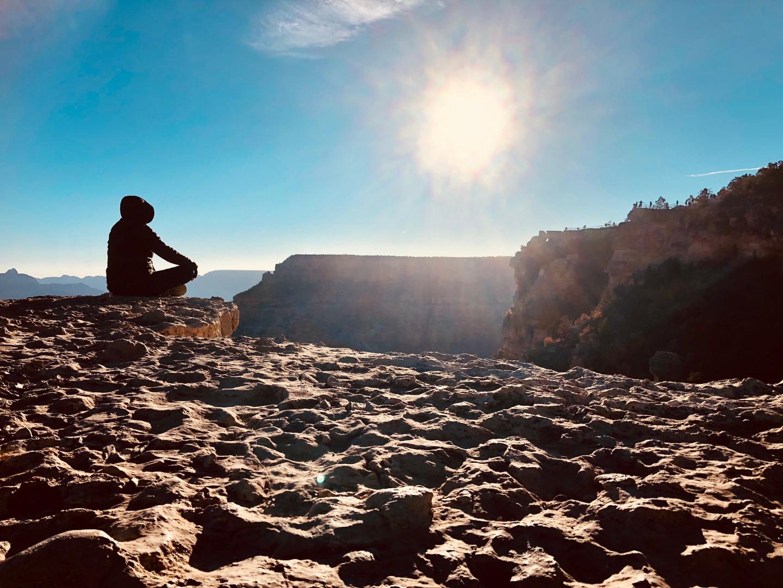 Woman meditating at the grand canyon